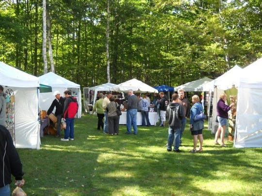 Visitors gather on the lawn outside Gills Rock Coffee for last year's Gills Rock ArtFest.
