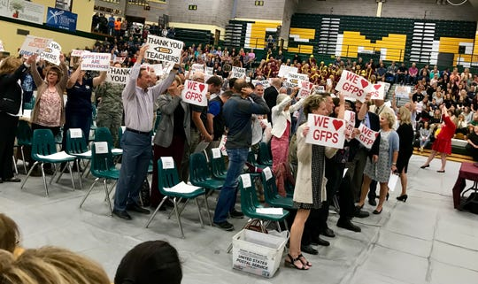 """GFPS community partners hold signs saying """"We (heart) GFPS"""" and """"thank you teachers,"""" among other slogans, at the Great Falls Public Schools teachers' convocation on Monday at CM Russell High School."""