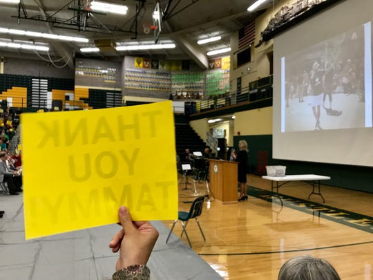 """Thank You Tammy!"" signs are waved at staff convocation as GFPS Superintendent Tammy Lacey announces this will be her last year in the role."