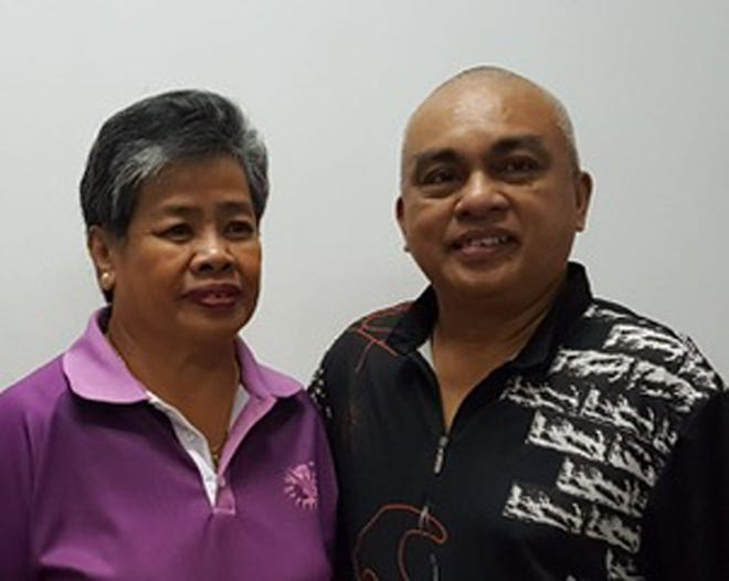 Manny Tagle, right, took home the first place win in the Guam Senior Bowlers Association August tournament on Aug. 26, 2018 at the Central Lanes bowling alley. He defeated Mary Pangelinan, left, to take the win.