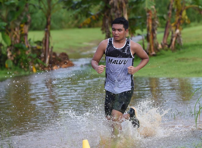 A Simon Sanchez High runner is shown competing in cross-country in this Aug. 27 file photo.
