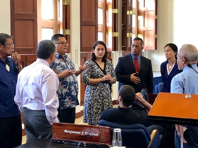 Legislative counsel Julian Aguon, third from left, gives senators guidance Monday morning related to a motion to place on the session floor Eric Palacios' nomination as director of Guam Customs and Quarantine Agency even without committee report. The motion was defeated by a vote of 9 to 5.
