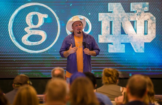 """Garth Brooks talks about plans for distributing his """"Triple Live"""" album during a Monday press conference at Notre Dame Stadium in South Bend, Ind."""