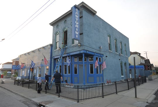 Investigators check out Santorini'Greek Kitchen following a 2010 fire that closed the Fountain Square restaurant for two months. Santorini continued successfully thereafter, but shuttered for good in March 2018 when the owners decided to focus attention on their catering business.