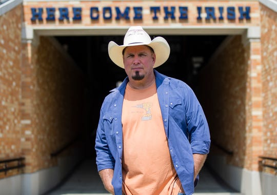 Garth Brooks poses inside Notre Dame Stadium Monday. The country music star will perform Oct. 20 at the venue.