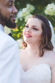Duran Pugh and Tracy Davis celebrate a re-creation of their wedding day, thanks to the gift of a local photographer and other wedding vendors.