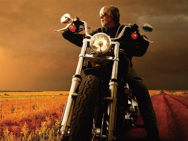 """Bob Seger is pictured on a motorcycle on the cover of his 2006 album """"Face the Promise."""""""