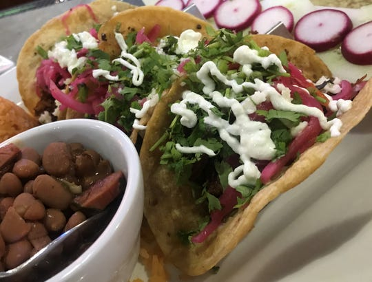 Brisket tacos with cilantro, sour cream and pickled red onions at Loco Mexican Restaurant & Cantina in the Fall Creek Place neighborhood of Indianapolis.