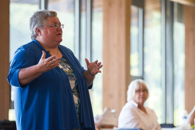 """Johnson County Supervisor Janelle Rettig accused the county of a """"lack of transparency"""" for selecting an architect for the Johnson County Access Center without a competitive bid process. Here Rettig speaks during an event for Iowa City RAGBRAI volunteers on Monday, Aug. 27, 2018, inside the Park Lodge at Terry Trueblood Recreation Area in Iowa City."""