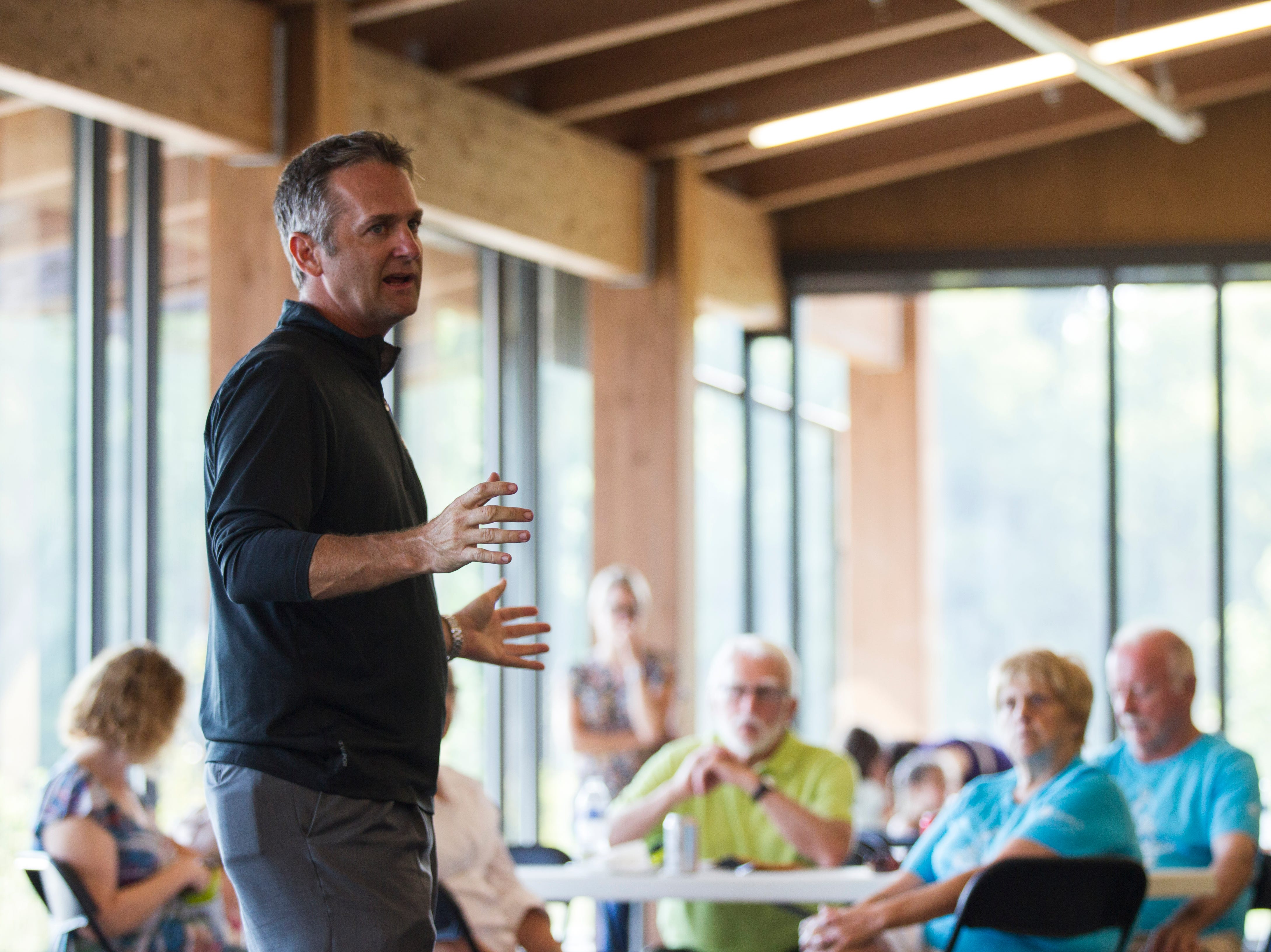 Josh Schamberger, president of Think Iowa City, speaks during an event for Iowa City RAGBRAI volunteers on Monday, Aug. 27, 2018, inside the Park Lodge at Terry Trueblood Recreation Area in Iowa City.