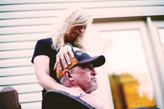 Gary Christian speaks on his back porch with his wife, Lori, at their West Knoxville home.