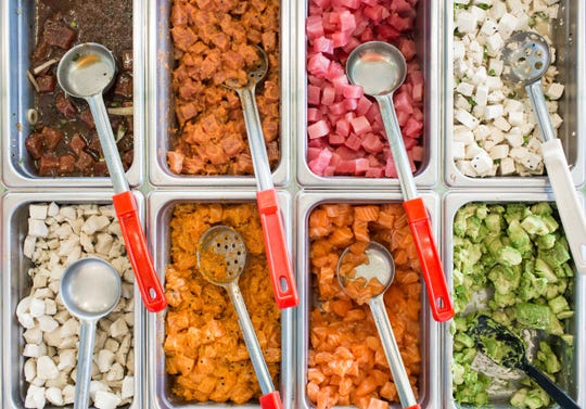 Make your own poke bowl at Poke Bros. by choosing from a selection of fresh toppings