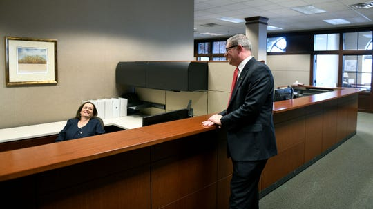 New Knoxville Utilities Board CEO Gabe Bolas jokes with outgoing CEO Mintha Roach in the KUB offices in downtown Knoxville on Thursday, Aug. 23, 2018.