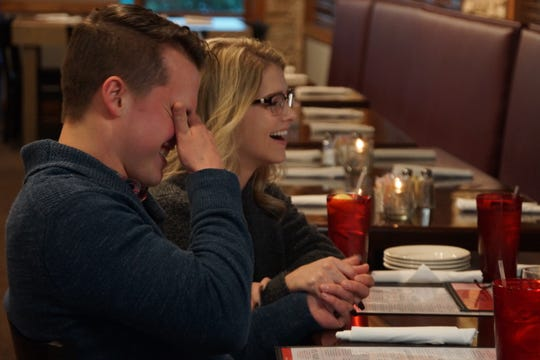 "Kelton Balka and Josie Bates laugh while at dinner with Josie's parents, Gil and Kelly Jo Bates, during an episode of ""Bringing Up Bates."""