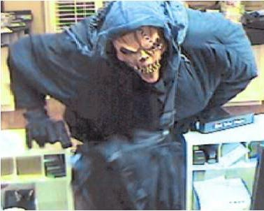 "The FBI is searching for information that may aid in the arrest of the ""Too Tall Bandit,"" seen here robbing Summer Bank & Trust in Gallatin."