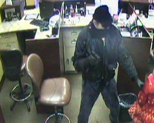 "The FBI is searching for information that may aid in the arrest of the ""Too Tall Bandit,"" seen here robbing Capital Bank in Farragut."