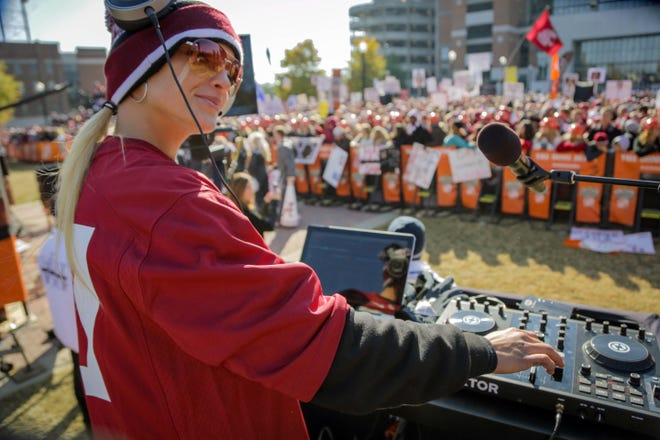 Former Lady Vol basketball player Cait McMahan works as a DJ for ESPN's College GameDay. While she's a Tennessee fan, she wears the home team's colors at each city the show travels to throughout the season.