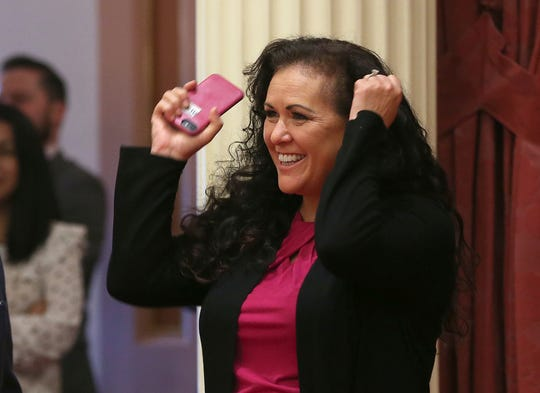 In this Aug. 22, 2018, photo, Assemblywoman Lorena Gonzalez Fletcher, D-San Diego, celebrates as the state Senate approves her forced arbitration bill in Sacramento, Calif. Her bill would bar employers from requiring forced arbitration agreements, which compel employees to settle workplace complaints instead of going to court, as a condition of employment. The bill now goes to Gov. Jerry Brown. (AP Photo/Rich Pedroncelli)