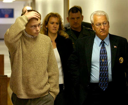 Campbell County High School shooter Kenny Bartley walks to a brief court appearance in Jacksboro flanked by Sheriff Ron McClellan, right, and several deputies. Bartley was appearing before Judge Michael A. Davis in charges stemming from the Nov 8 fatal shooting of assistant principal Ken Bruce and the wounding of principal Gary Seale and assistant principal Jim Pierce.