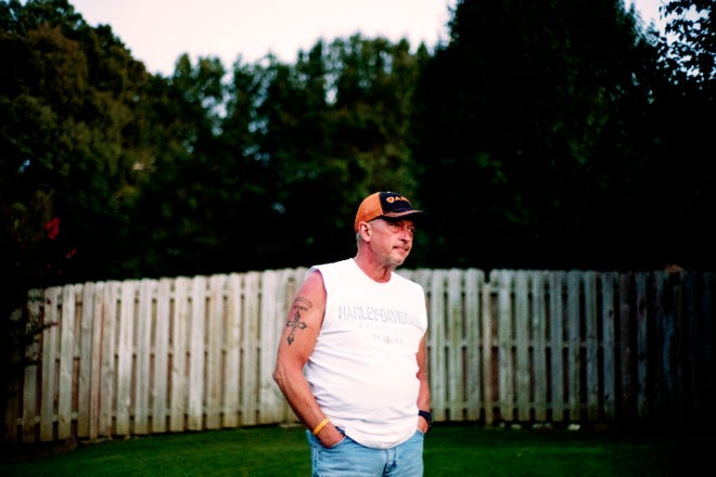 Gary Christian poses for a photo at his West Knoxville home on Thursday, August 23, 2018. Christian lived for 11 years filled with rage over the murder of his 21-year-old daughter, Channon.