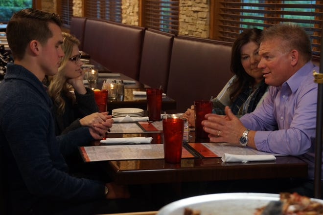 "From left, Kelton Balka, Josie Bates, Kelly Jo Bates and Gil Bates talk at dinner during an episode of ""Bringing Up Bates."""