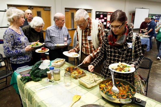 Members of The Vegetarian Society of East Tennessee enjoy a potluck dinner.