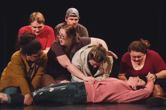 """Tennessee Wesleyan students perform a scene from """"Lockdown."""" From left, actors are Cynthia Linley, Kyle Martin, Michaela Akins, Alex Williams, Hailey Maxwell, Breann Pruitt and Emylea Ferguson."""