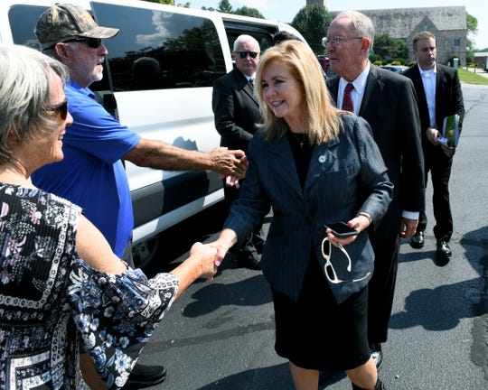 Rep. Marsha Blackburn (running for senate) and Sen. Lamar Alexander greet citizens as they arrive to talk to media following their tours of ORNL and Y-12 Monday, August 27, 2018.