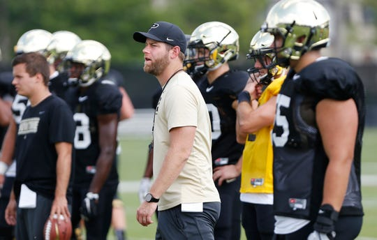 Quarterbacks coach and co-offensive coordinator Brian Brohm watches as players run plays during Purdue football practice Monday, August 27, 2018, in West Lafayette.