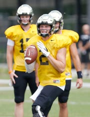 Quarterback Elijah Sindelar gets set to pass during Purdue football practice Monday, August 27, 2018, in West Lafayette.