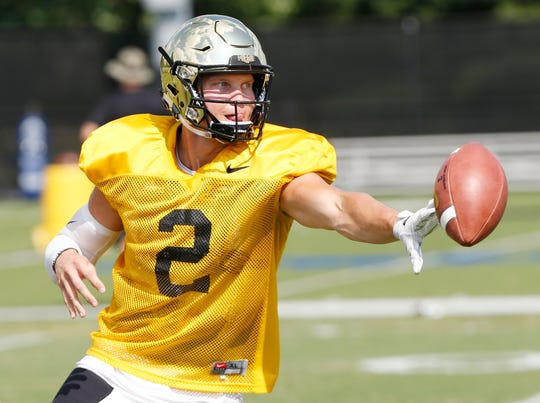 Quarterback Elijah Sindelar with an option pitch during Purdue football practice Monday, August 27, 2018, in West Lafayette.