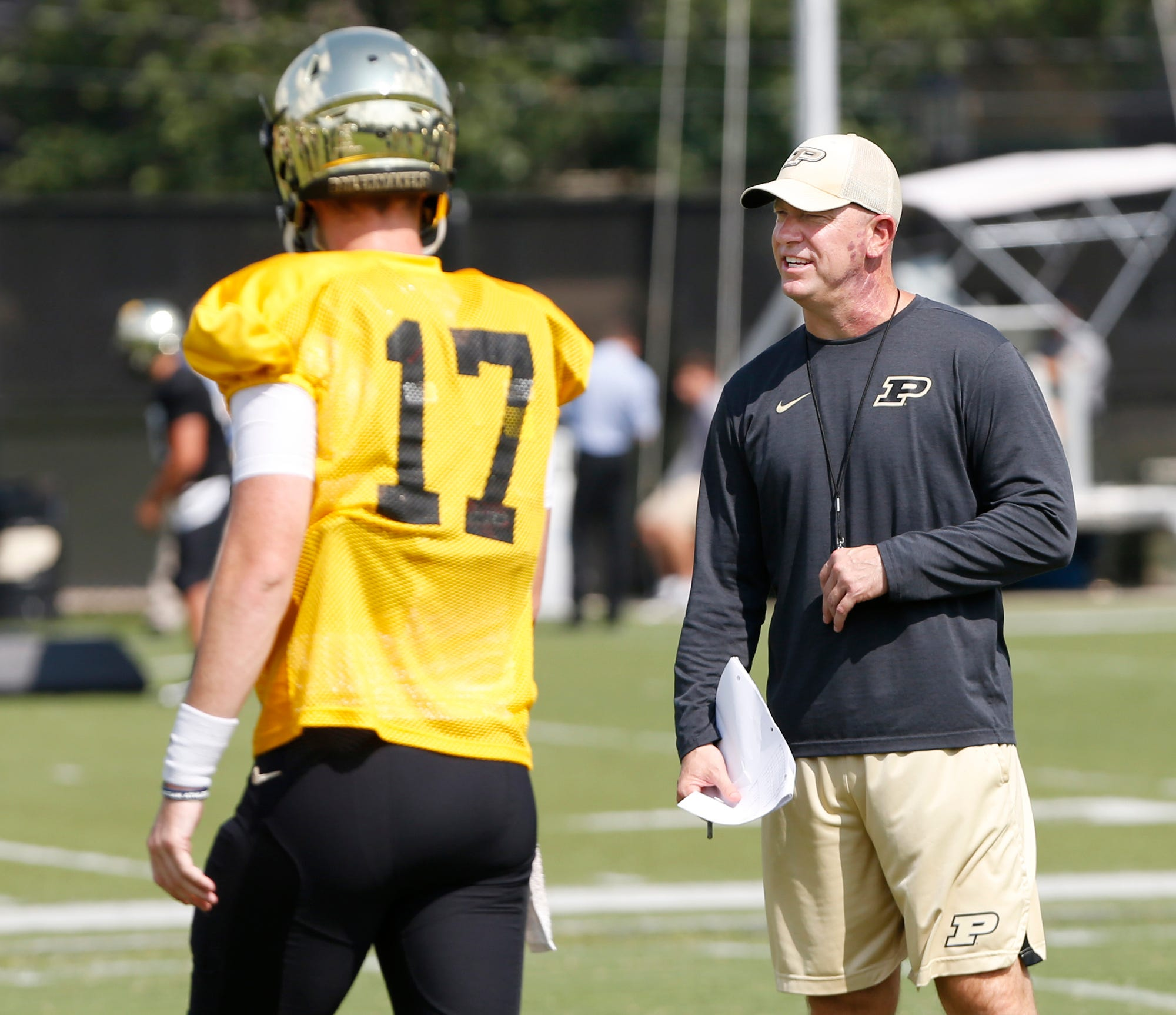 Head coach Jeff Brohm calls out a play during Purdue football practice Monday, August 27, 2018, in West Lafayette.