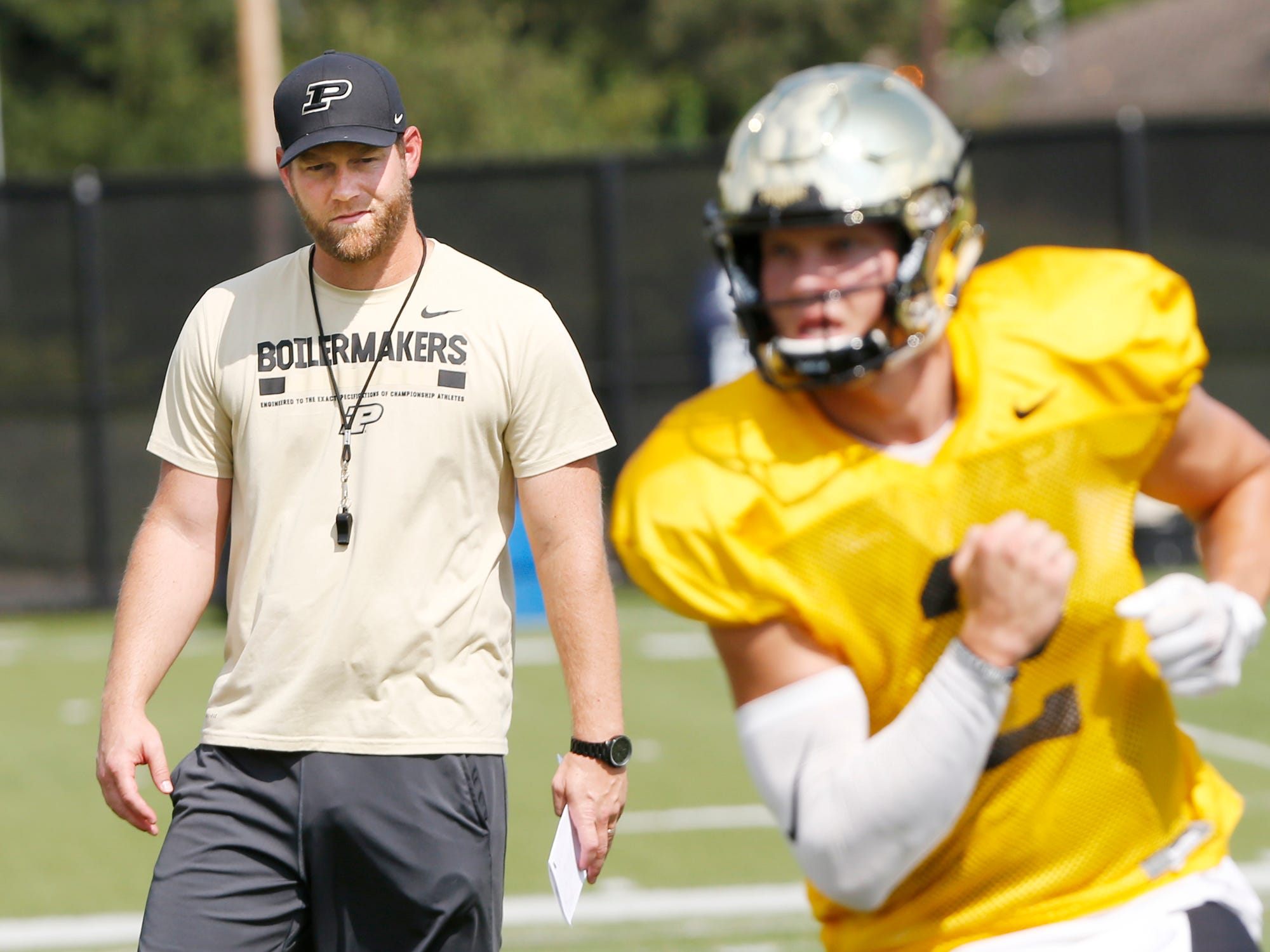 Quarterbacks coach and co-offensive coordinator Brian Brohm watches as quarterbacks run drills during Purdue football practice Monday, August 27, 2018, in West Lafayette.