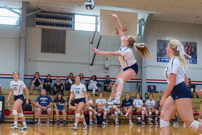 Addie Vidrine hitting from the back row at the Teurlings Catholic  Volleyball Jamboree. Thursday, Aug. 23, 2018.