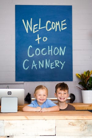Siblings Demi, 4, and Dawson Latiolais, 8,  regularly help out at Cochon Cannery.