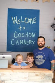 Siblings Demi, 4, and Dawson, 8,  help their dad, Dustie Latiolais, out at Cochon Cannery.
