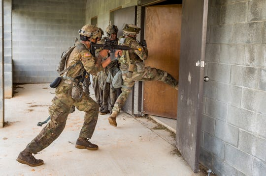 Soldiers from the Louisiana National Guard's 256th Infantry Brigade conduct field training exercises during XCTC Training at Camp Shelby, Mississippi on July 31, 2018.