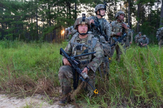 Soldiers from the 3rd Battalion Bravo Company prepare to depart for live fire training exercise during XCTC Training at Camp Shelby on July 24, 2018.