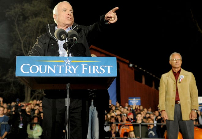 Sen. John McCain points to the crowd during a campaign event Oct. 26, 2008 at Ohio University Lancaster. Behind McCain is Fairfield County resident Tom Moe, a friend of McCain's since their time as prisoners of war in Vietnam.