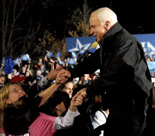 Sen. John McCain shakes hands with a crowd of supporters Oct. 26, 2018, during a presidential campaign rally at Ohio University Lancaster.