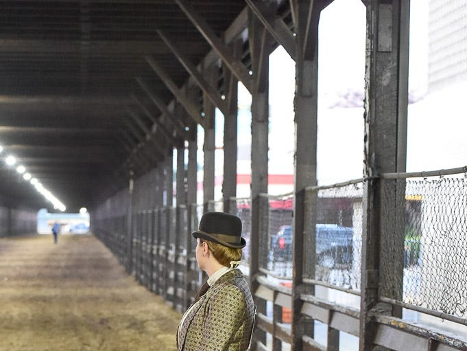 Laura Plant waits for her horse to come up Stophers Walk