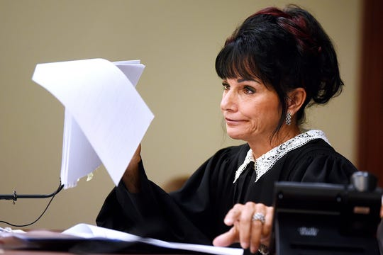 Circuit Judge Rosemarie Aquilina pauses while reading portions of a letter Larry Nassar submitted to her in the original sentencing hearing as Aquilina addresses the attorneys during a hearing on a motion seeking a new sentence for Nassar on Monday, Aug. 27, 2018, in Ingham County Circuit Court in Lansing.