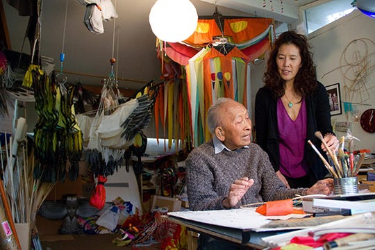 """Tyrus Wong (left) with Pamela Tom, a fifth-generation Chinese American producer, director and screenwriter who produced a documentary about Wong in 2015 titled """"Tyrus."""""""