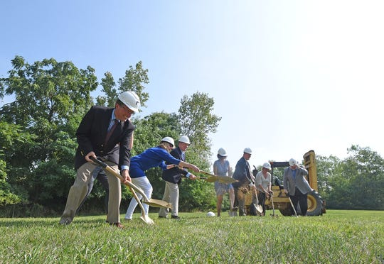 Local dignitaries help break ground Monday morning for the new Catalyst Detox Center on Scholl Road.