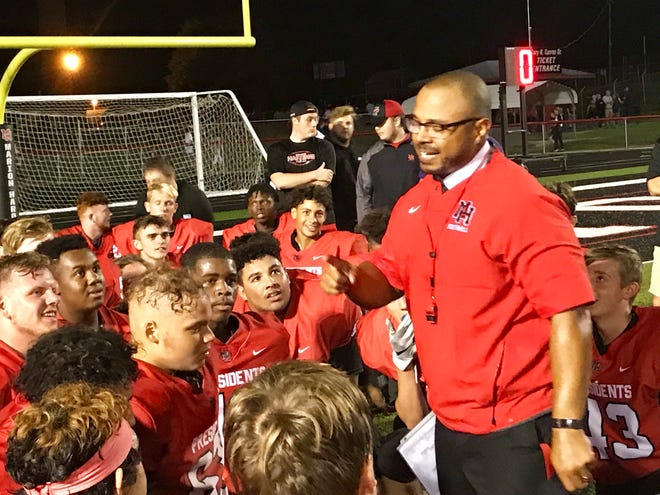 Marion Harding football coach addresses his team after a 21-12 season-opening win over Mount Vernon Friday night at Harding Stadium.