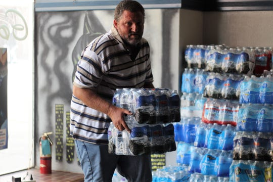 Residents of Marion dropped off over 500 cases of water to the bar. The water will make it into the hands of Flint residents who sometimes wait in line for hours for free bottled water and filters.