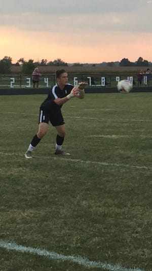 Pleasant goalkeeper Evan Roark warms up before a match at River Valley last season. He returns as a senior for the Spartans.