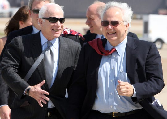 FedEx CEO Fred Smith (right) chats with John McCain in 2008.