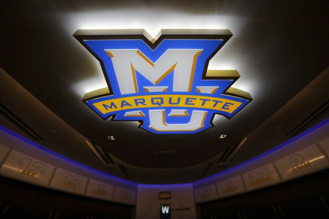 The Marquette logo in the locker room at Fiserv Forum.