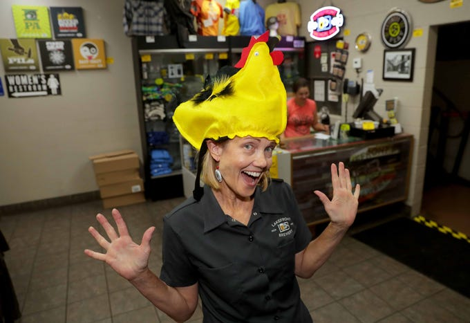 Chris Ranson, Lakefront Brewery's tours and environmental programmer, models a chicken hat, one of the many Wisconsin-inspired merchandise for sale in the brewery gift shop.